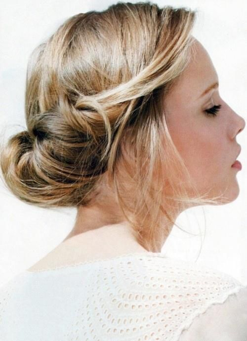 Tucked updo with a fancy comb and the loose parts curled