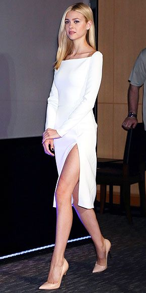 NICOLA PELTZ It may appear to be just a basic cream sheath, but the Transformers: Age of Extinction actress's Christian Dior dress, worn to the movie's Tokyo press conference, boasts an insanely high side slit, plus it's got a sexy corset-style lace-up back.