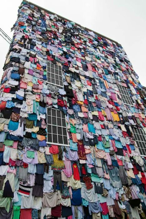 Covering the outside of a four-story building like tattered shingles, 10,000 colorful garments hang – and they represent just five minutes' worth of discarded clothing in the United Kingdom. The 'Shwopping' campaign by UK retailer Marks & Spencer
