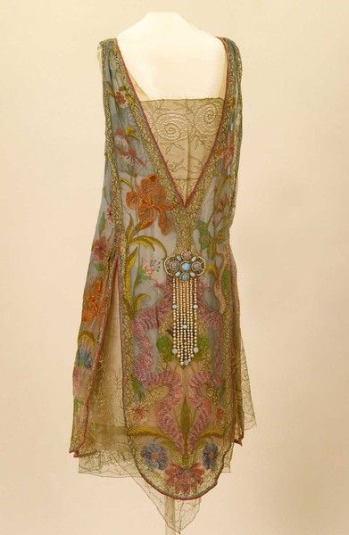 Callot Soeurs, Designer (French) ca.1926. Irises and water avens adorn this…