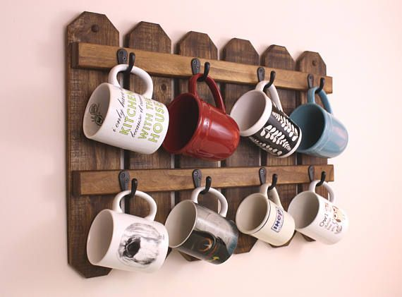 Bring in a little Country Charm to warm your rustic kitchen decor. This 8 cup coffee mug holder is just the ticket. Made from rustic pallet wood,finished just enough so it retains its unique snappy character. Makes a great holiday gift. Will easily accommodate 8 - average 16oz. mugs.