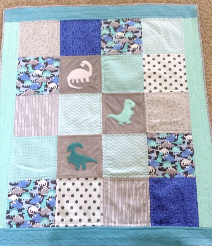 Darling Dinosaur quilt in teal, aqua and gray with soft cuddly back by Lovesewnseams on Etsy https://www.etsy.com/listing/195374390/darling-dinosaur-quilt-in-teal-aqua-and