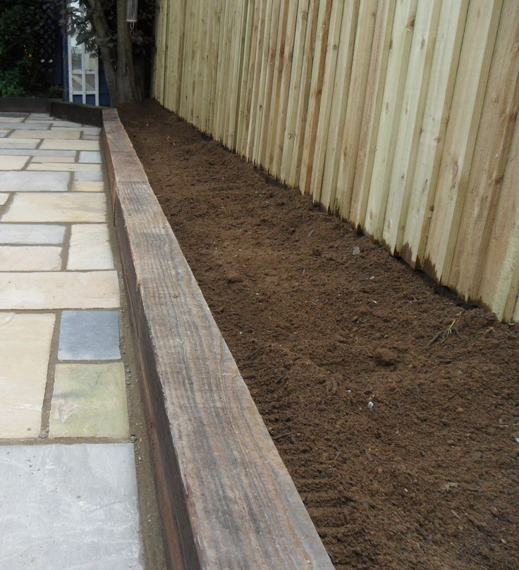 Flower beds made out of railway sleepers ready for planting.