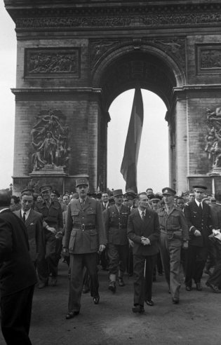 General Charles de Gaulle, who led the French government-in-exile for four long, occasionally despairing years, at the Arc de Triomphe during the Liberation of Paris on Aug. 25, 1944.