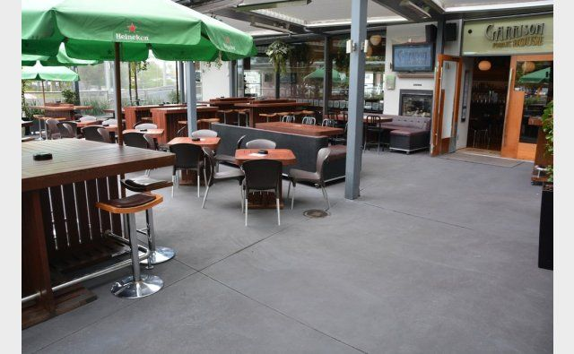 Peter Fell Coloured Concrete | At Garrison Bar, 350 sq m of tiles replaced with concrete - in three days!