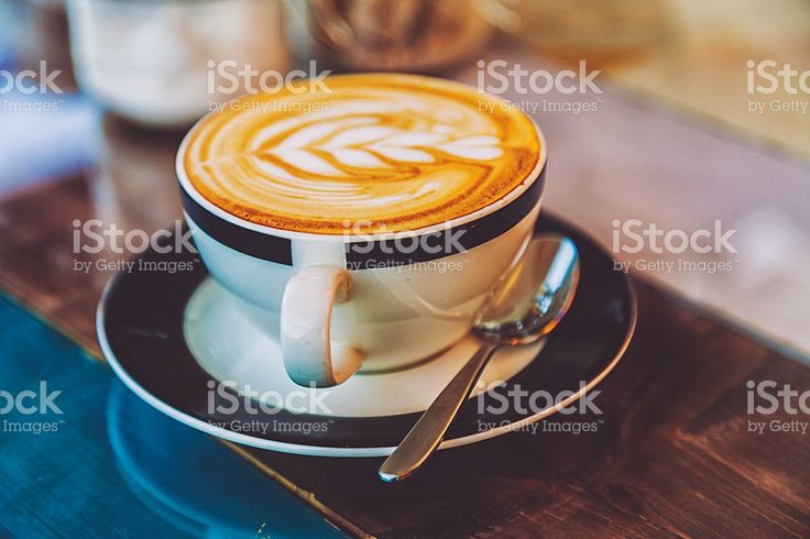 Cup of hot latte art coffee on wooden table royalty-free stock photo