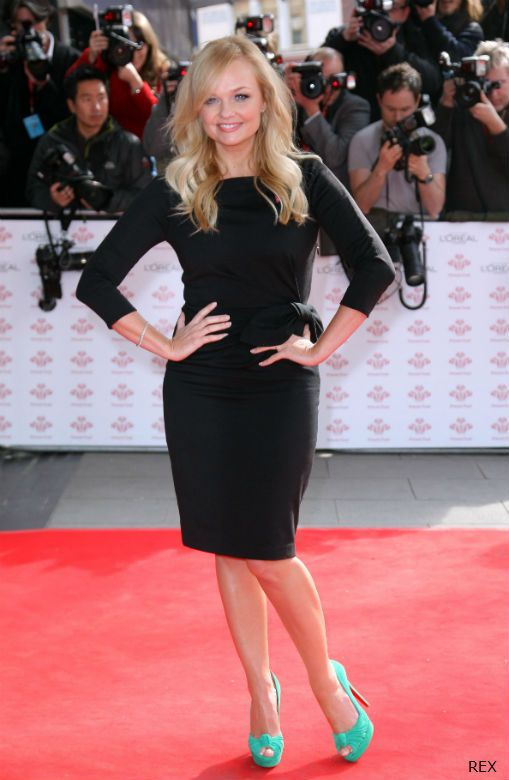 Emma Bunton looked tres chic in a gorgeous black shift dress and colour-pop turquoise platforms this week. What a flattering fit! http://bit.ly/wBQ8ar