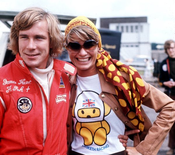 1974–  James Hunt & wife Suzy Miller at the British Grand Prix.