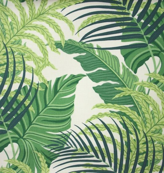 Manila Fabric A printed fabric featuring overlapping fern and palm foliage in…