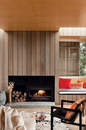 Vertical ash-toned plank installed full wall of living room.