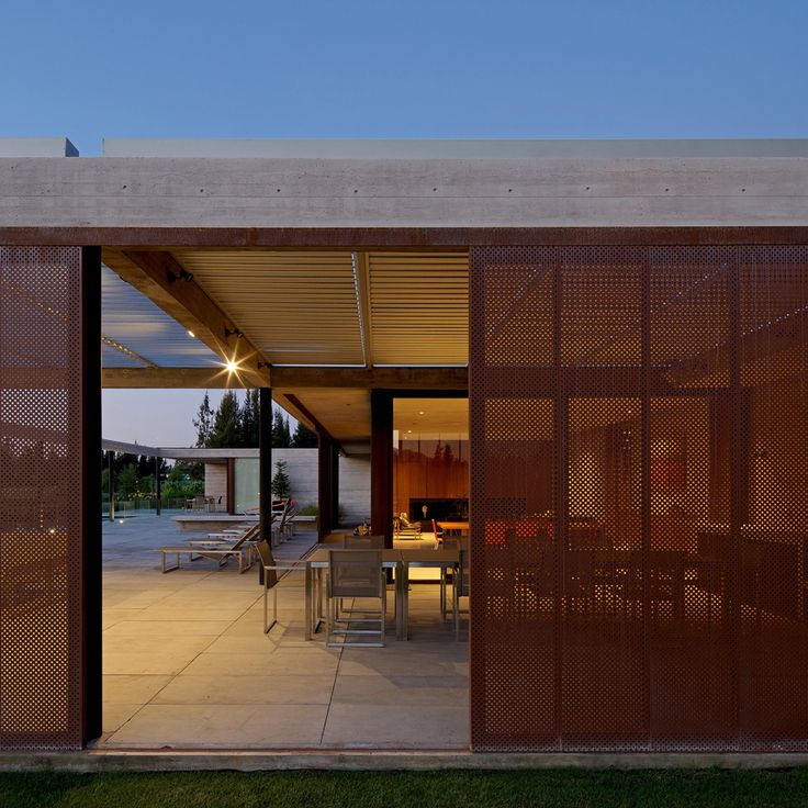 Cristian Hrdalo adds protective steel screens to house beside a golf course in Chile