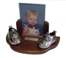 Silver plated baby shoes on walnut base with 5x7 photo frame by…