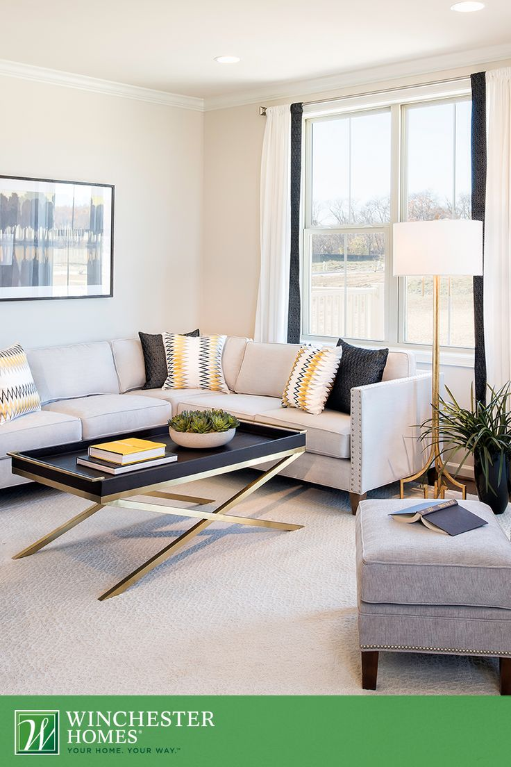With A Gold Toned Floor Lamp And Coffee Table The Living Room In