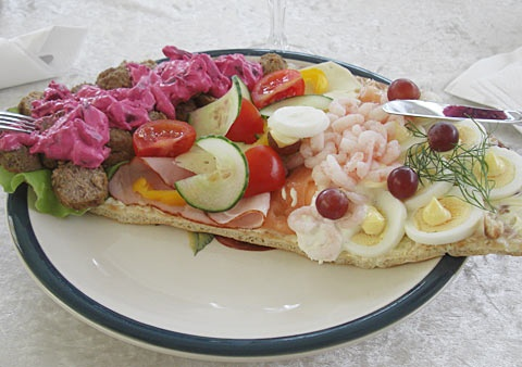"Swedish ""Landgång"". A traditional Swedish sandwich, toppings vary from one end to the other: usually fish/seafood in one end, meats in the other along with various creamy salads and pates - on a slice of bread cut lengthwise."