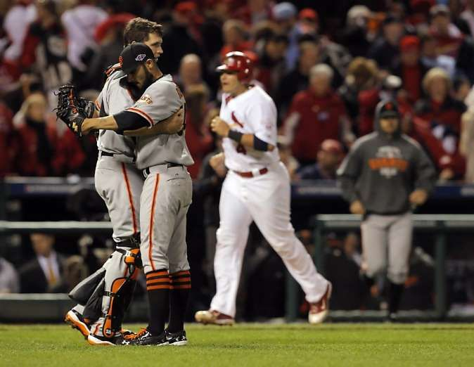 Buster Posey: 'I would love nothing more' than to retire as a Giant   -  July 10, 2017:    Sergio Romo gets a hug from Buster Posey as Yadier Molina walks back to the Cardinals dugout and Barry Zito emerges to celebrate with teammates. The San Francisco Giants played the St. Louis Cardinals in Game 5 of the National League Championship Series at Busch Stadium on Friday, October 19, 2012, in St. Louis, Mo. The Giants defeated the Cardinals 5-0...  MORE...