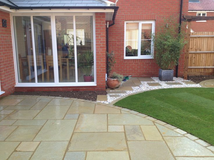 A Welcoming Patio With Circular Lawn Area, Perfect For Entertaining.
