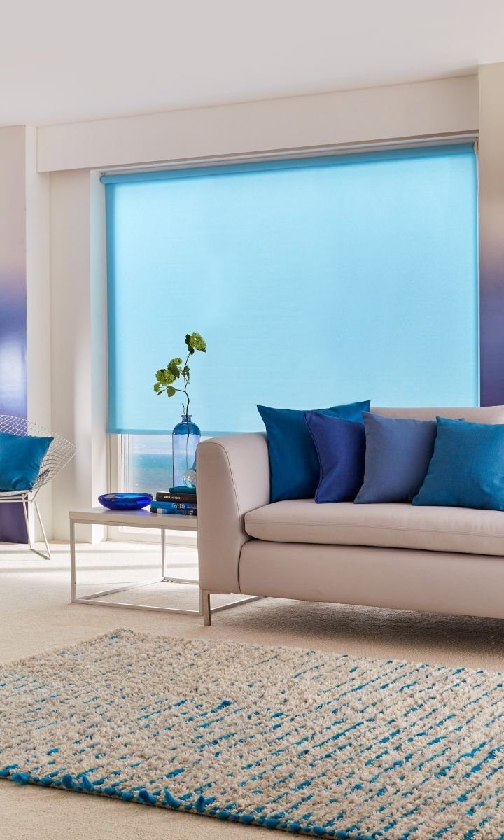 Tonal blue and cream creates a wonderful coastal feel to a room. Use ombre for a fully modern take on the theme. Made to measure Acacia Azure Roller blind it perfect for this look.