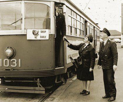 Driver Alan Dacey, Conductress Dot Rango and Depot Starter Ben Opie at Preston Depot in 1964. Official M&MTB photograph.