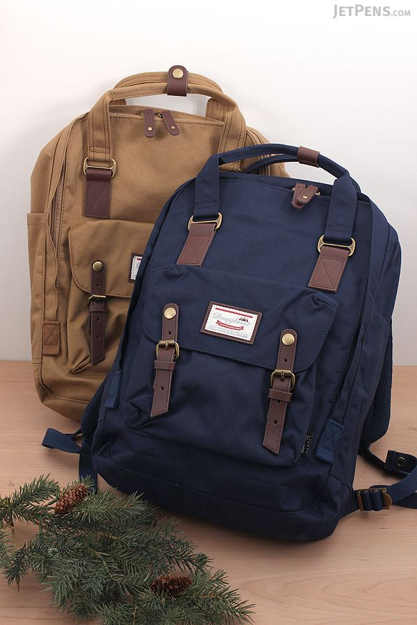 3a3f44f9b41 The full-size Doughnut Macaroon Large Cordura Backpack is made for travel  and commuting.