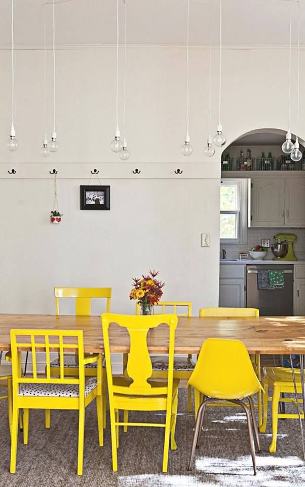 mismatched yellow dining chairs