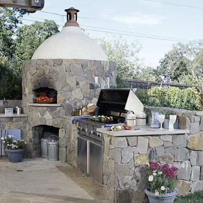 Wood-Burning Oven..Outdoor kitchens offer several advantages over their indoor counterparts, including being able to cook at much higher temperatures. The focal point of this kitchen is the wood-burning oven, which can reach significantly higher temperatures than interior ovens.