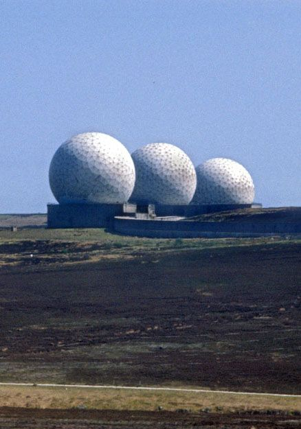 Three giant golf balls entirely in scale with the vast open landscape of the North York Moors. These 40-metre diameter geodesic domes (radomes) housing mechanical radar dishes were installed by RCA in 1962 at RAF Fylingdales, Snod Hill, North Yorkshire UK, as part of the USA's cold war Ballistic Missile Early Warning Station network. They were replaced in 1989-1992 with a tetrahedron (pyramid) structure.