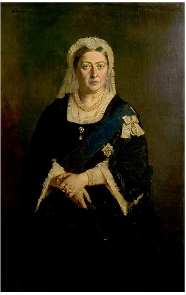 Portrait of Queen Victoria (1819-1901) by Heinrich Anton von Angeli, 1887. The Austrian portraitist Henrich von Angeli was favored by Queen Victoria taking the place of Franz Xaver Winterhalter after his death in 1873. This is a copy of a portrait made in 1875. During the 1875 sittings she wrote: 'It is quite en face, hands crossed before me as I stand, my usual Evening Cap & a black satin dress cut square as I wear them in the winter.'
