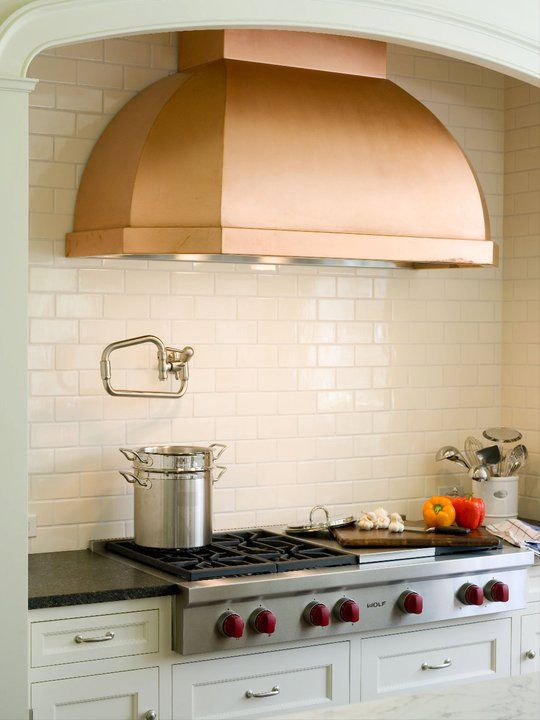 Copper is a popular accent in kitchens again.  This range-hood looks striking against the subway tile. (love the mixed metals in the room.)  by Alisberg Parker Architects (Beauty Kitchens Hoods)
