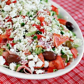 Chopped Antipasto Salad. Mine looked very similar--butter lettuce mix, sliced green and black olives, chopped cucumber, grape tomatoes, feta crumbles and shredded mozzarella and the only cured meat I had, summer sausage. Very tasty! Next time need red onions, pepperoni and ham, maybe provolone cheese.