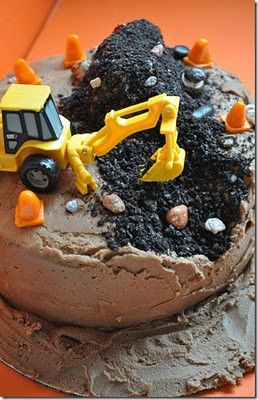 """Construction cake. I especially like how one side is a little scooped out. Demerara sugar + brown sugar + dutch cocoa powder sprinkled over chocolate icing makes a fairly convincing """"ground."""" Going to try this with pulverized oreos (maybe oreos + chocolate sprinkles?) for the dirt pile."""
