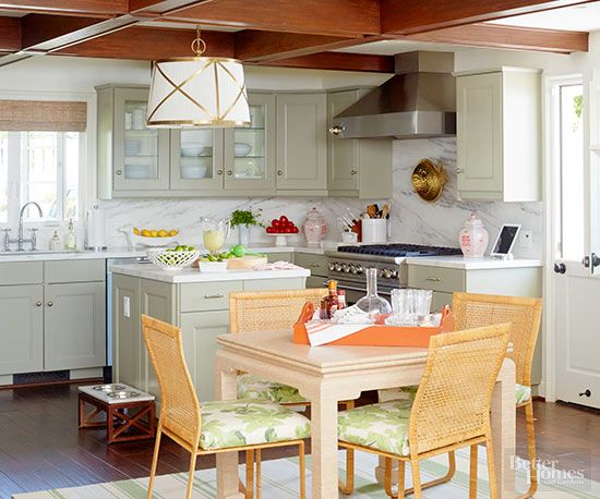A limited color palette and repeating materials create an easy flow throughout the kitchen and dining area.