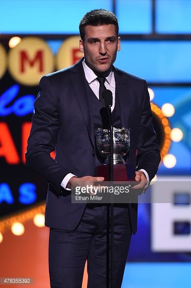 Patrice Bergeron of the Boston Bruins accepts the Frank J. Selke Trophy during the 2015 NHL Awards at MGM Grand Garden Arena on June 24, 2015 in Las Vegas, Nevada.