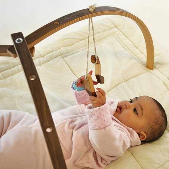 Wooden baby gym for hanging baby mobiles by StudioMishela on Etsy - because we probably won't have enough apartment for one that doesn't fold up.