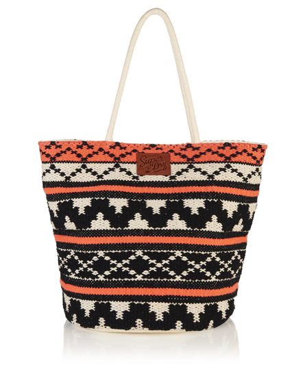 #superdry Superdry women's Whitney beach tote bag. This beach tote is roomy enough for all your beach essentials and folds flat for easy packing. This woven geometric detail tote features popper fastening and two inner pockets. The Whitney beach tote is fully lined and is finished with a leather Superdry logo badge on the front. H 33cm x L 45cm x D 30cm 3185244500061YUB007 Pink Condition | new