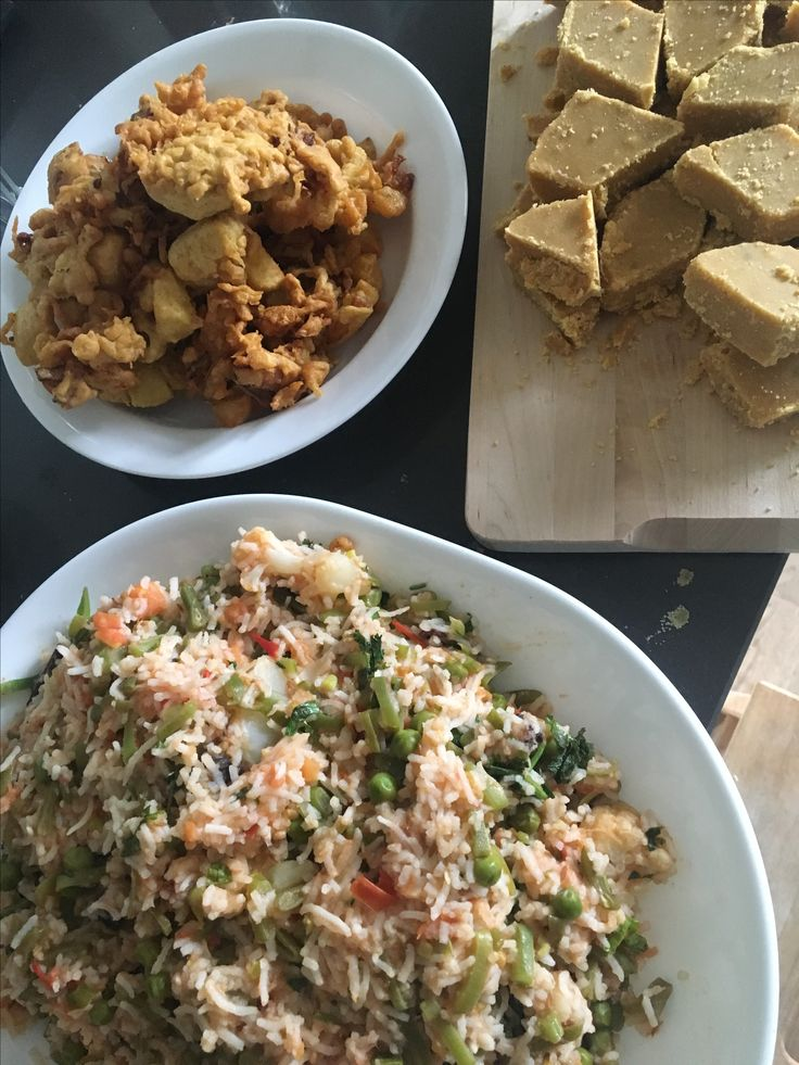 The flavours, fragrance and colours of a simple , home cooked, Diwali meal, at home in Amsterdam. East meets West. A tomato-veg pulao, onion pakodas (fritters) and 'besan ki barfi' (an Indian sweet made from gram flour, sugar and butter). Cooked by me! :)