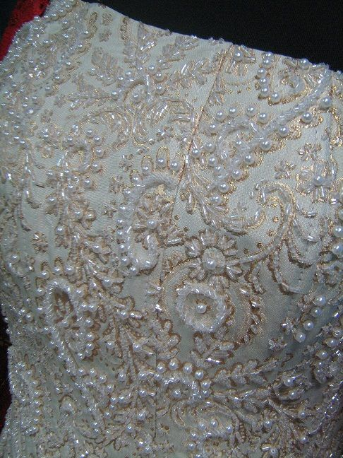 Hand embroidery with beads and pearls on a woman's corset
