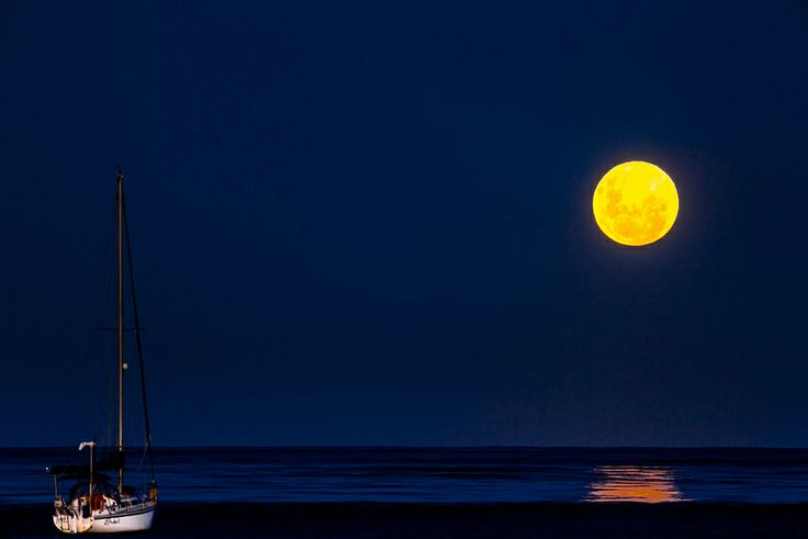 Moonrise With One Boat