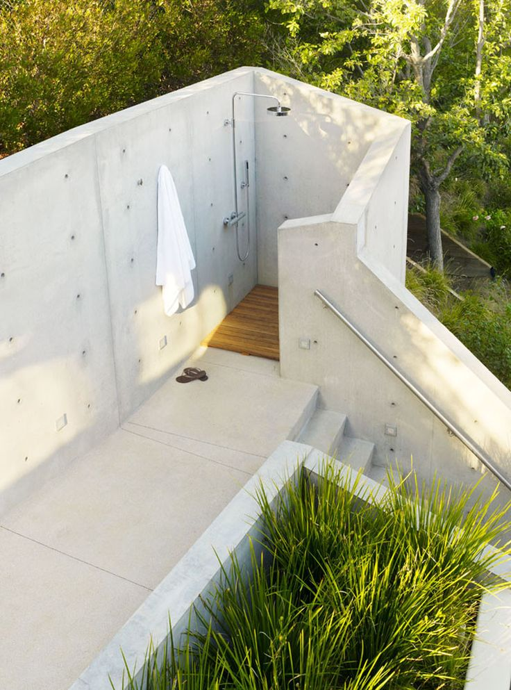outdoor bathroom vent cover%0A Outdoor shower surrounded by concrete walls at The Banyan Treehouse by  Rockefeller Partners Architects