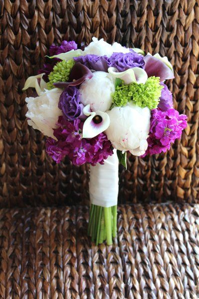 Like types of flowers: Purple, white and green bouquet of peonies, hydrangea, calla lilies, stock, and lisianthus