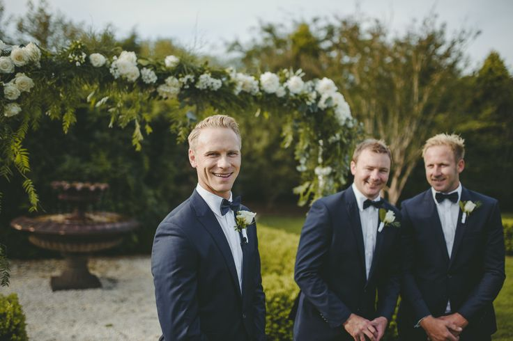 Groom's all smiles before the Bride arrives. Scott Surplice photography.