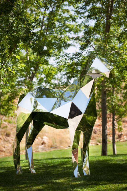 Xavier Veilhan - mirrored silver metallic horse sculpture in the trees.