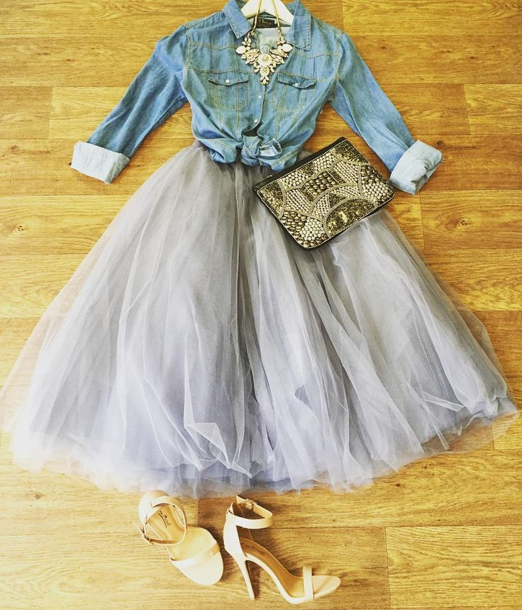 How romantic is this look? Tulle skirt in gray paired with light denim shirt and statement necklace.