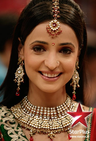 Khushi looks ecstatic in this heavy red and golden neckpiece.