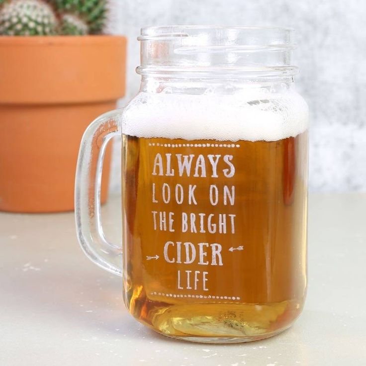 This glass mason drinking jar, engraved with 'Always Look on the Bright Cider Life', makes the perfect finish to your Friday evening.This unique 'always look on the bright cider life' mason jar is machine engraved in the UK by Lisa Angel. This handled mason jar is the best way to enjoy your favourite cider on a Friday night. Not for use with hot drinks. <em>Please be aware: if you choose either left or right handed, your glass will be engraved on the side facing away from you as you…