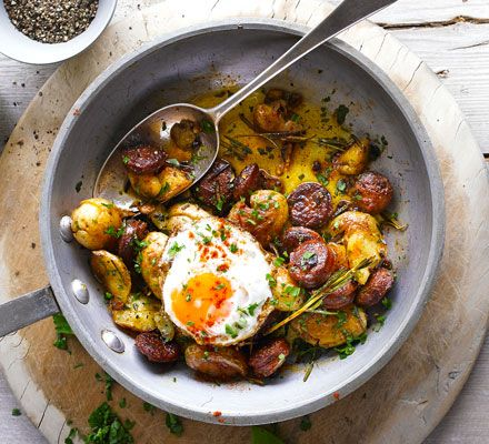 Start the day with this rustic, beautiful brunch dish of crispy, smoked paprika-flecked potatoes with rosemary, crushed garlic and fried eggs