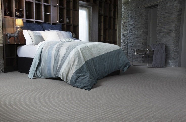 A rich bedroom of teal, navy and grey is complimented by a warm Feltex Classic carpet.  Unbeatable softness and style.