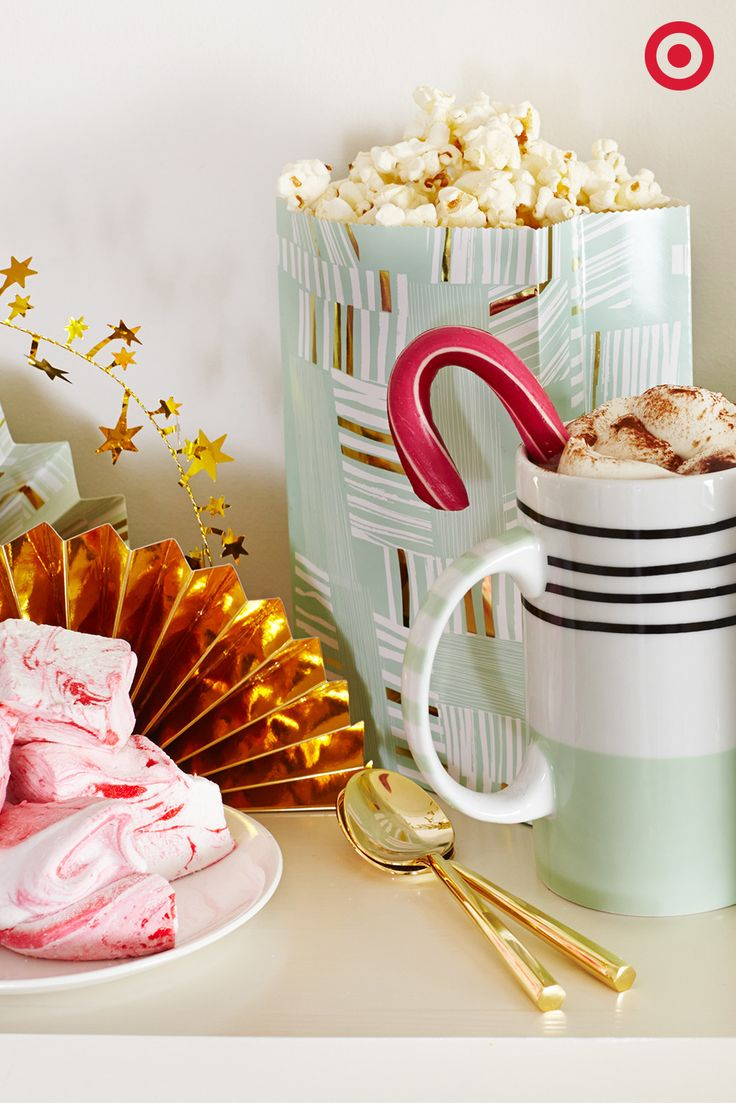 A steaming cup of hot chocolate, marbled marshmallows and savory popcorn—the perfect holiday party spread. Shop the Oh Joy for Target collection.