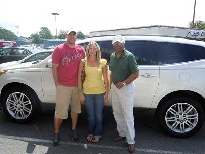 Folger Subaru Sales Consultant Bill Barber with the Atwell's and their 2011 Chevy Traverse!