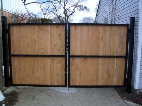 Wood steel motorized gate by lighthouse door company for Garage fence