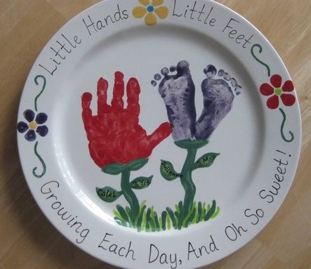 "Handprint & Footprint Platter I made at a ""Paint Your Own Pottery"" store.  (Writing around the edge and on the leaves is porcelain pen- written on the fired plate, then baked on.)"